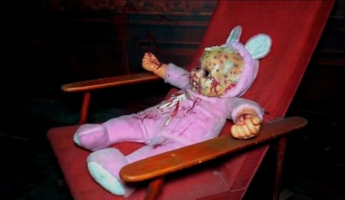 Dead doll in a chair